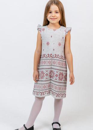 Платье детское из плотной хлопковой ткани.