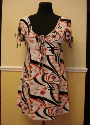 Трикотажное платье-туника подойдет для беременных большого раз...