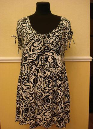 Трикотажное платье-туника  подойдет для беременных большого ра...