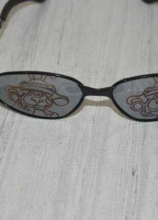 Детские солнечные очки foster grant с рисунком на стеклах.