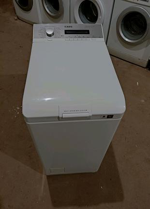 Пральна машина з вертикальним завантаженням AEG