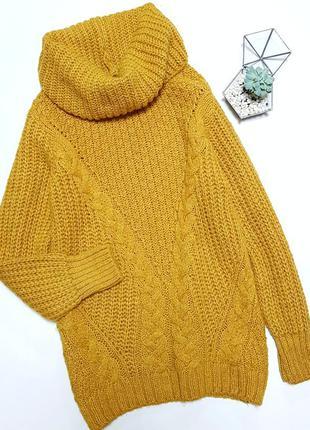 Красивый желтый вязаный свитер туника