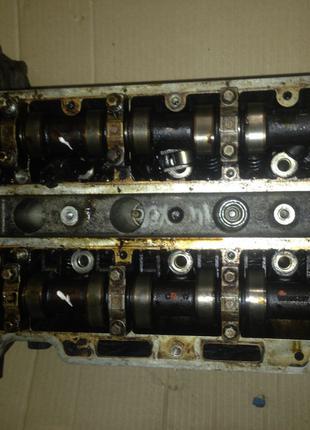 Головка блока цилиндров ГБЦ распредвал Z14XEP Opel Astra 55568429