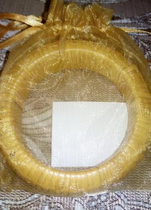 Браслет плетеный в этническом стиле в подарочном мешочке из ор...