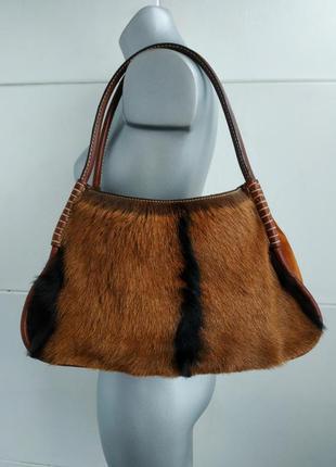 Кожаная сумка tod's  из высококачественной, мягкой, натурально...