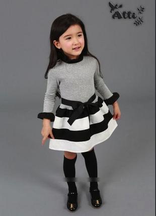 Модное нарядное платье для девочки с полосатой юбкой