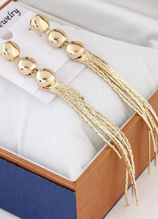 Длинные серьги золотистые .