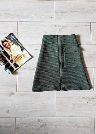 Фактурная юбка трапецией с накладным карманом