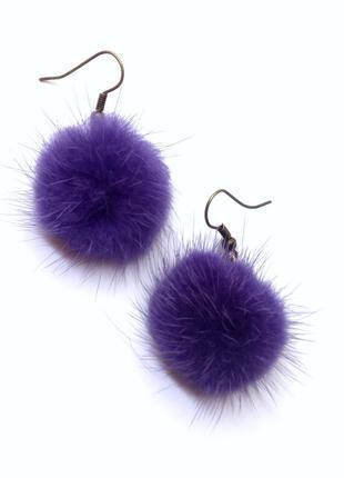 Серьги из натуральной норки фиолетового цвета.