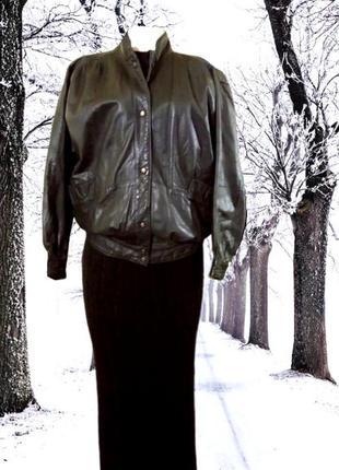Объемная черная женская кожаная куртка на кнопках, на нескольк...