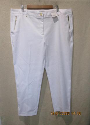 Стильные зауженные стрейчевые брюки с золотой фурнитурой/котто...