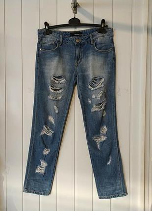 Женские рваные джинсы с дырками
