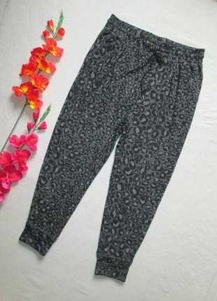Трикотажные спортивные брюки с принтом и манжетами высокая пос...
