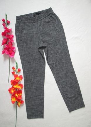 Элегантные стильные шикарные меланжевые стрейчевые брюки на ре...