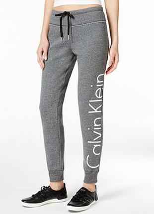 Фирменные трикотажные теплые  спортивные брюки с начесом серый...