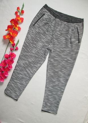 Крутые фактурные меланжевые брюки спортивного типа с лампасами...