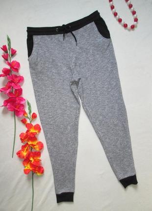 Трикотажные стрейчевые спортивные брюки серый меланж с манжета...