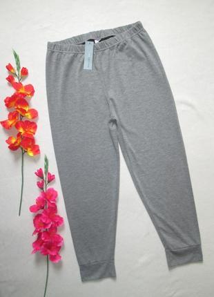 Трикотажные спортивные брюки серый меланж с манжетами высокая ...