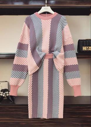 Вязаный костюм с юбкой миди.