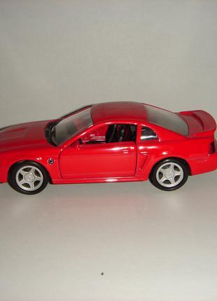 Продам машинку металлическую FORD MUSTANG 1999.