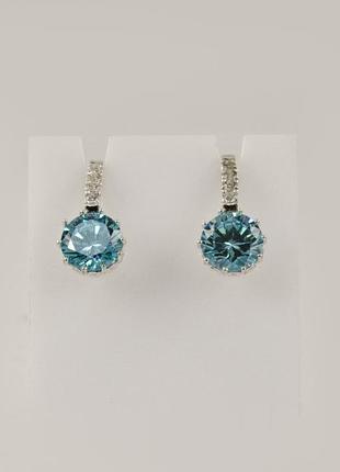 Сережки с голубыми камнями
