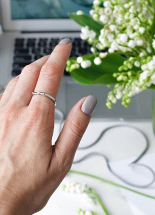 Серебряное кольцо маленький бантик