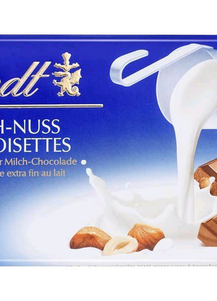 Швейцарский молочный шоколад Lindt  milch-nuss