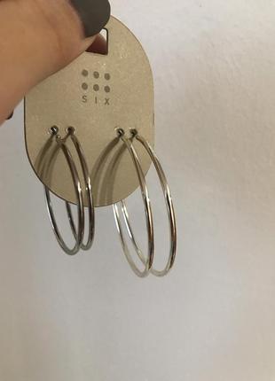 Круглые сережки серьги кольца серебро разного диаметра украшен...