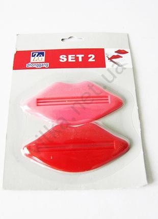 Выдавливатель пластмассовый для тюбиков из 2-х Губы 9 х 4 см.