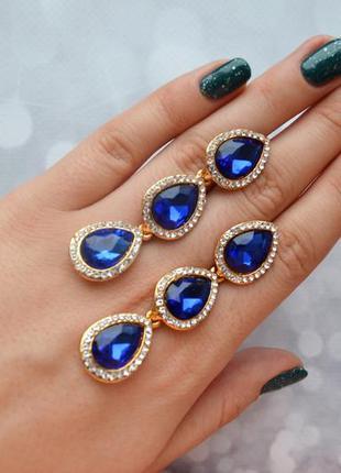 Вечерние серьги-капельки с синими камнями в золоте
