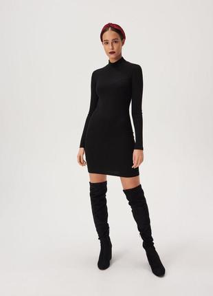 Трикотажное новое платье по фигуре