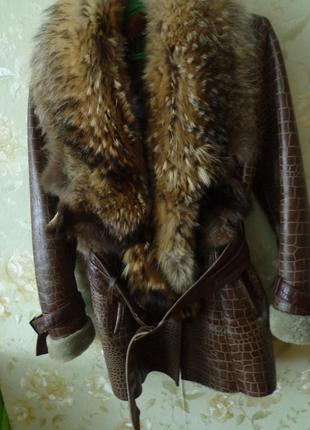 Кожаная куртка с мехом енота натуралка