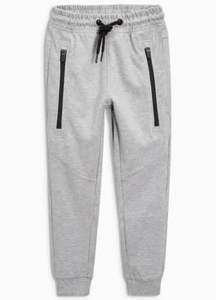 Спортивные штаны next на 10-11 лет , плотные и теплые