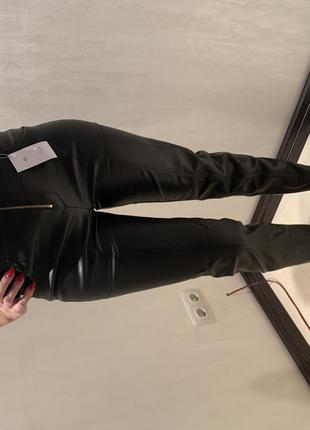 Кожаные штаны женские