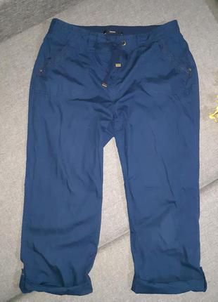 Темно- синие бриджи, шорты сзади на резинке