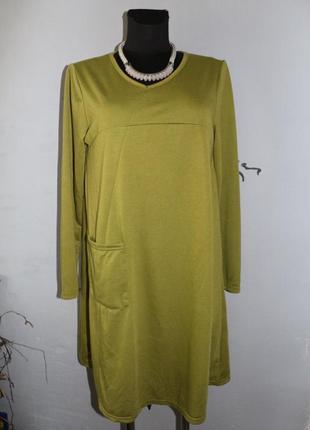 Зеленое осеннее трикотажное платье трапеция