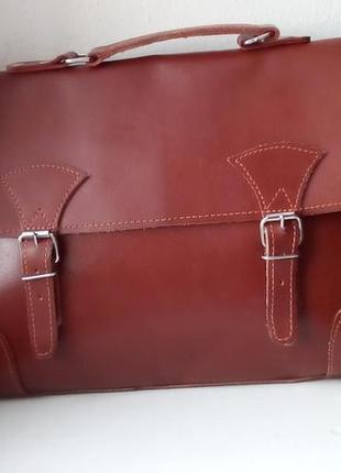 Качественная кожаная сумка с длинным ремнем. новая