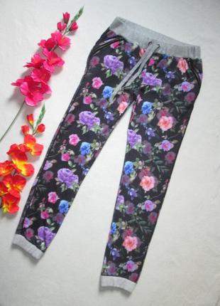 Бесподобные трикотажные спортивные штаны с начесом  в цветочны...