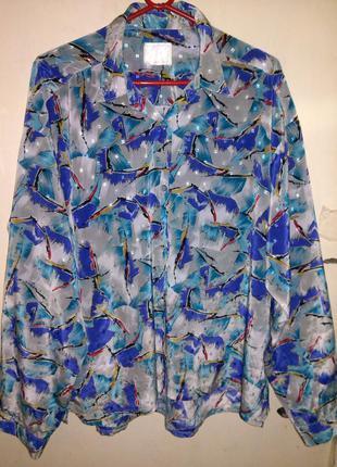 Натуральная,яркая блуза,рубашка на пуговицах,с удлинённой спин...