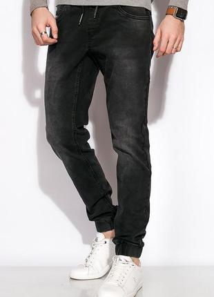 Потертые джинсы с манжетами