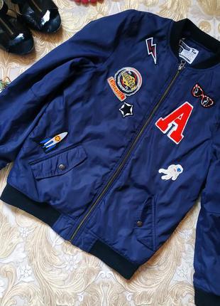 Прикольная куртка. на бирке- 11-12 лет.