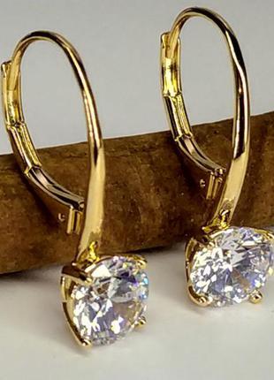 Позолоченные серьги с  большим переливающимся кристаллом, сере...
