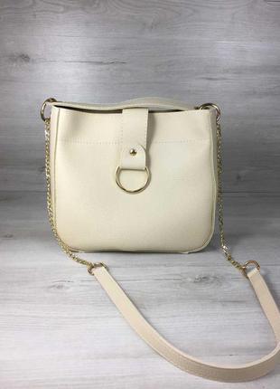 Бежевая женская сумка через плечо с шипами ручкой и ремешком