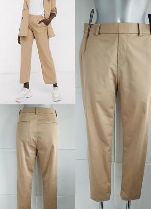 Стильные брюки uniqlo бежевого цвета
