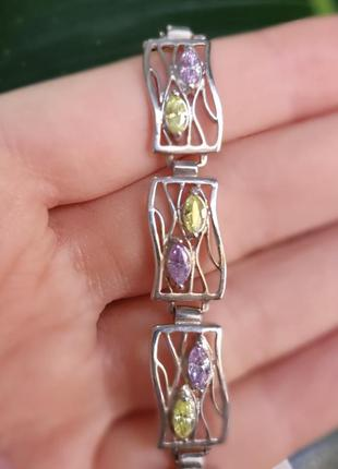 Браслет серебро 925, с фиолетовыми и желтыми фианитами.
