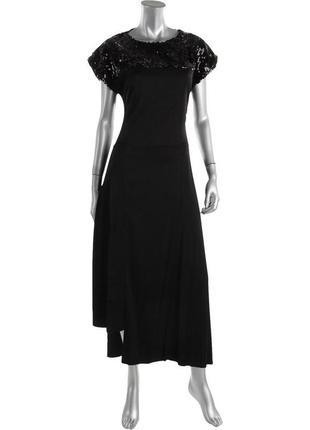 Коктейльное платье а-силуэт с вырезом на спине и эффектной юбк...