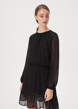 Расклешенное платье с воланом