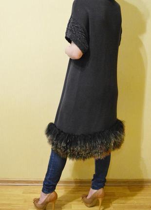 Вязаный кардиган, жакет, пиджак  внизу с натуральным мехом коз...