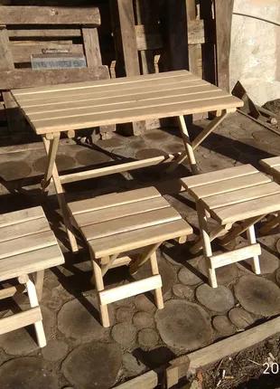 Раскладной стол со стульями из дуба.