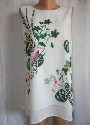 Белая блуза с красивым принтом